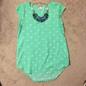 Green polka dot blouse